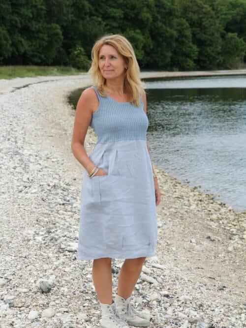 Woman in light blue linen dress