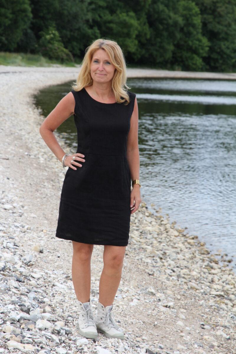Woman in black linen dress
