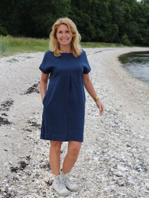 Woman in blue linen dress