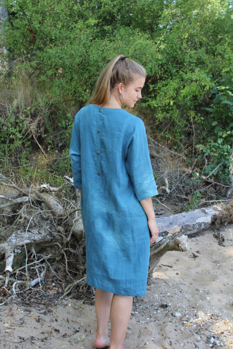 Woman in blue linen dress from the back