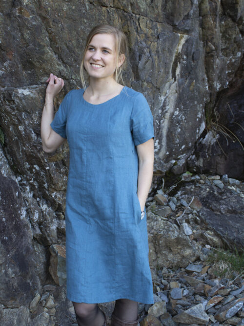 Woman in linen dress with short sleeves