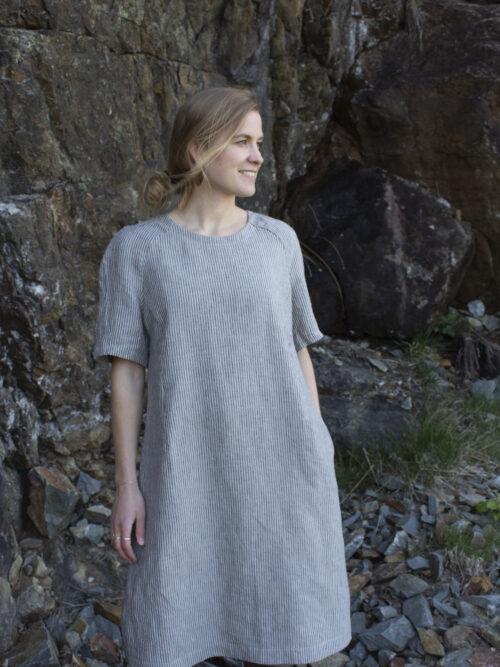 Woman in striped linen dress
