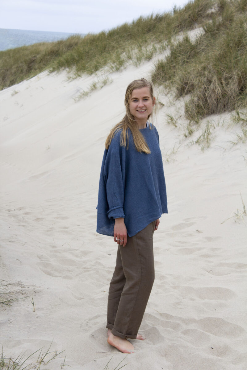 Woman in blue knitted linen blouse and brown linen pants