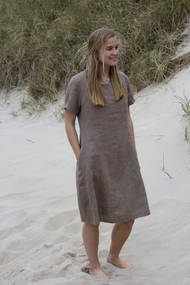 Woman in brown linen dress