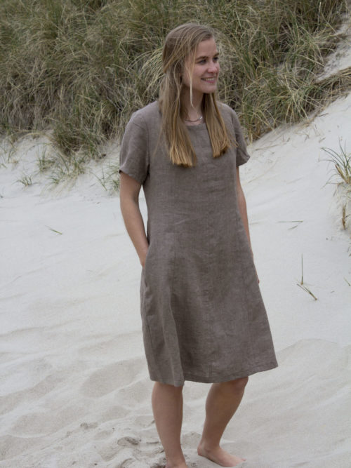 Woman in brown linen dress