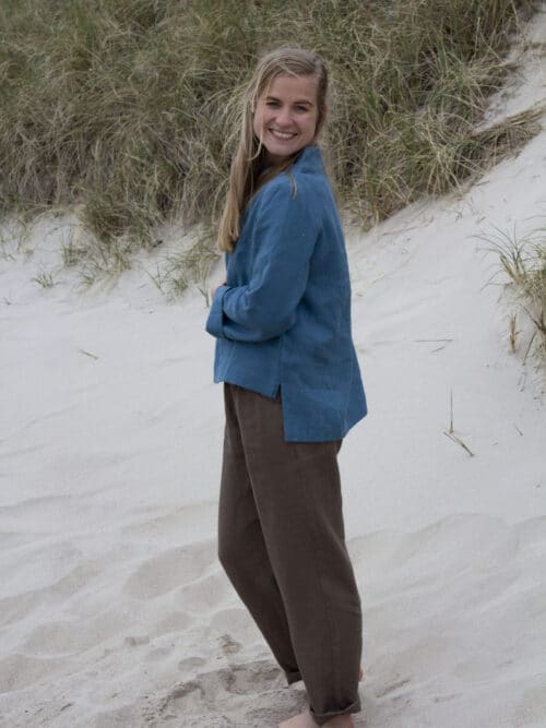 Woman in blue linen blouse and brown linen pants