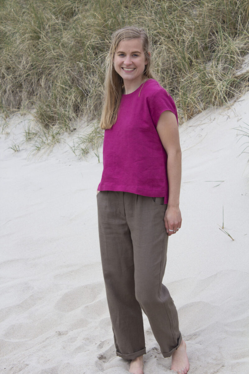 Woman in cherise linen top and brown linen pants