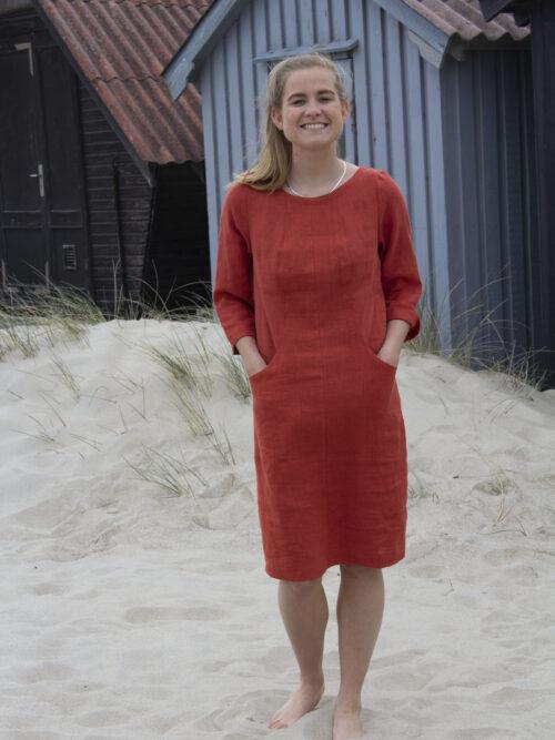 Woman in red linen dress