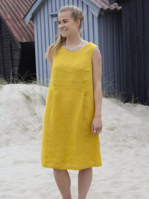 Woman wearing a yellow linen dress