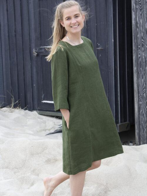 Woman in forest green linen dress