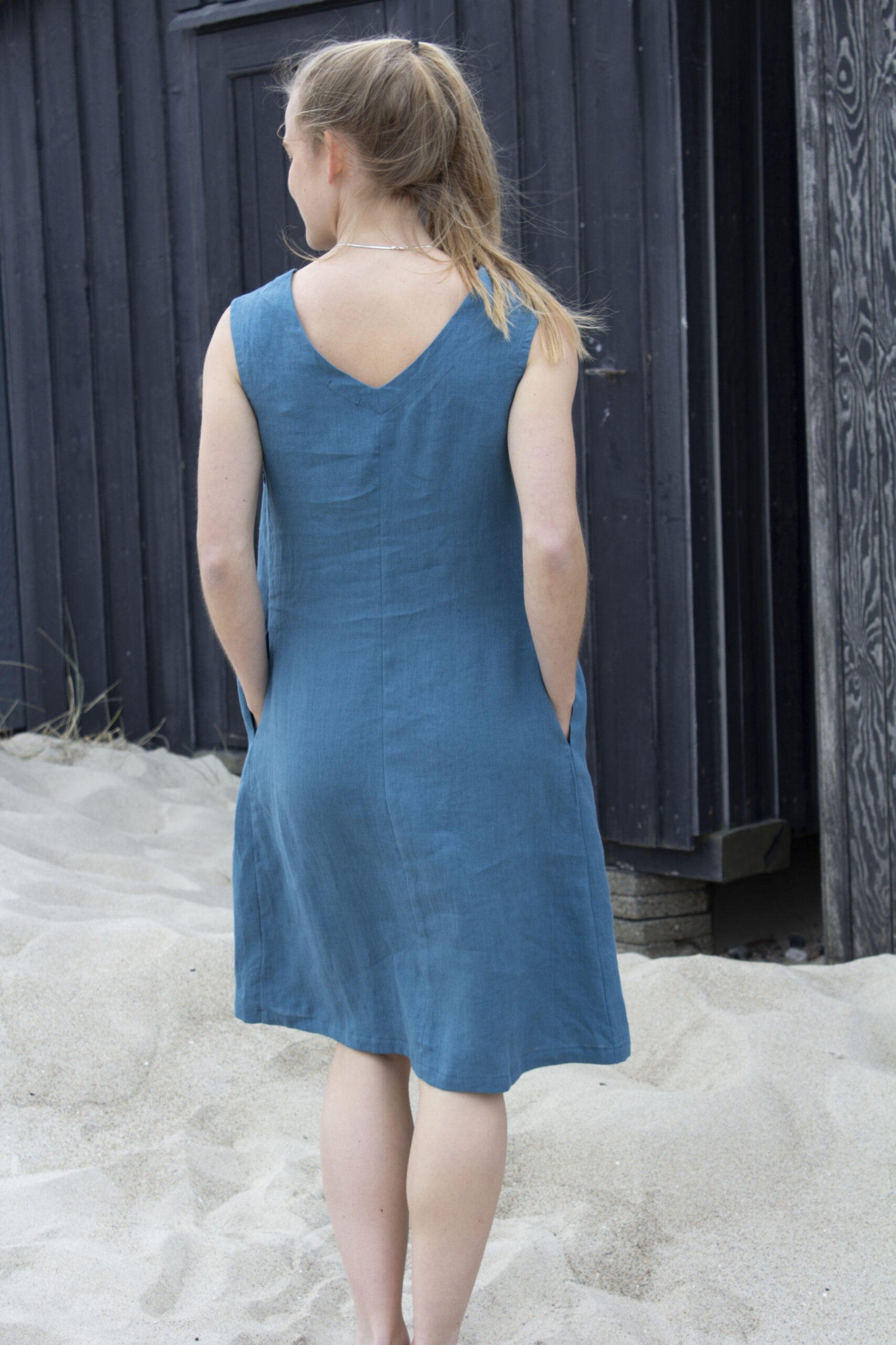 Woman from the back in blue linen dress