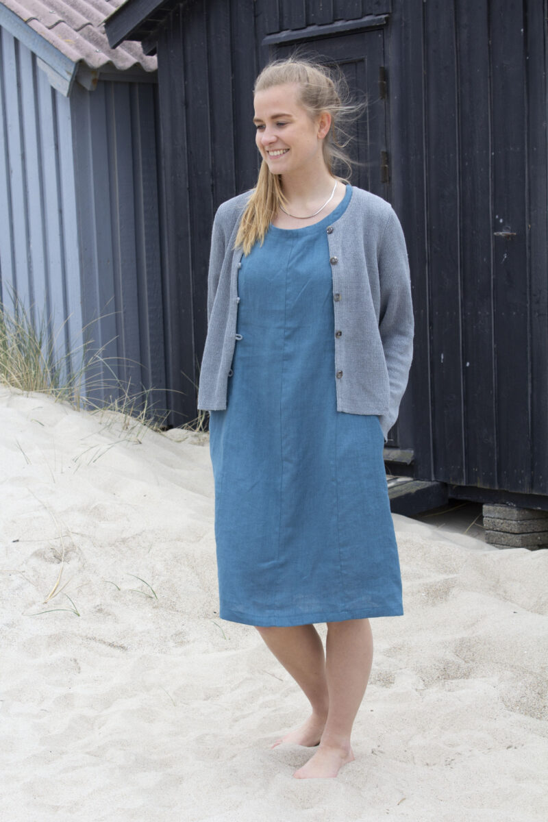 Woman in blue line dress and grey knitted linen cardigan