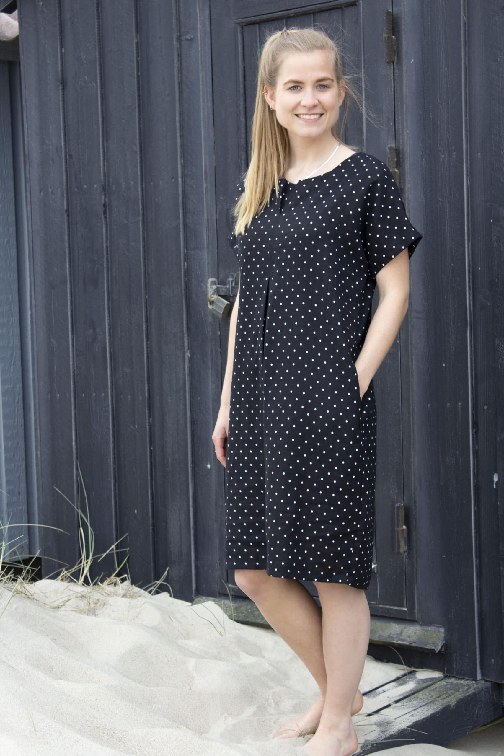 Woman in black dress with white dots