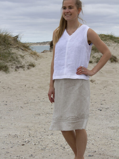 Woman in white linen top and linen skirt