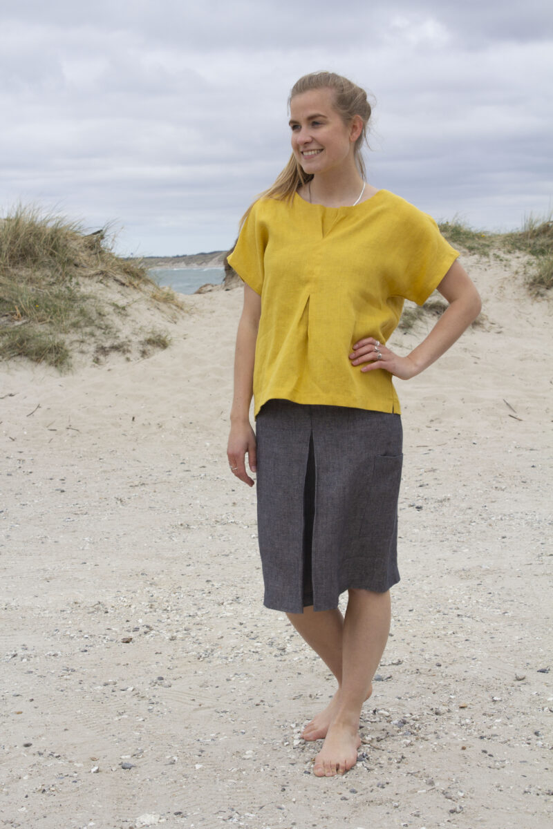 Woman in yellow linen top and grey linen skirt