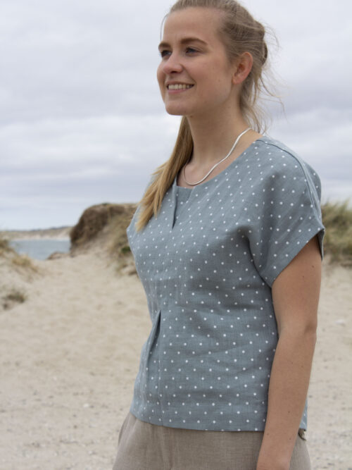 Woman in green linen top with white dots