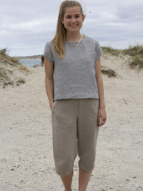 Woman in striped linen top and natural linen pants