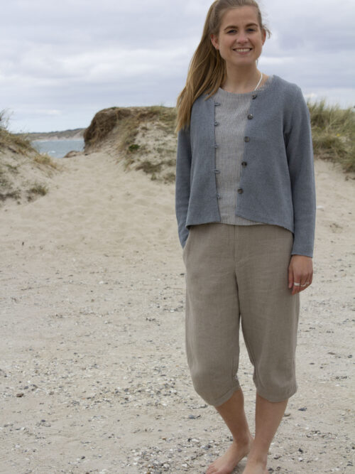 Woman in striped linen top, grey knitted linen cardigan, and linen pants