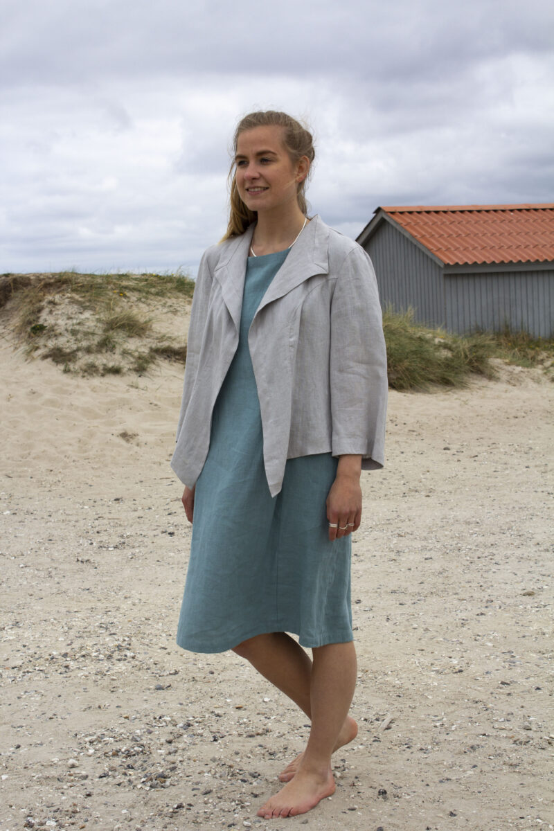 woman in grey linen jacket and linen dress