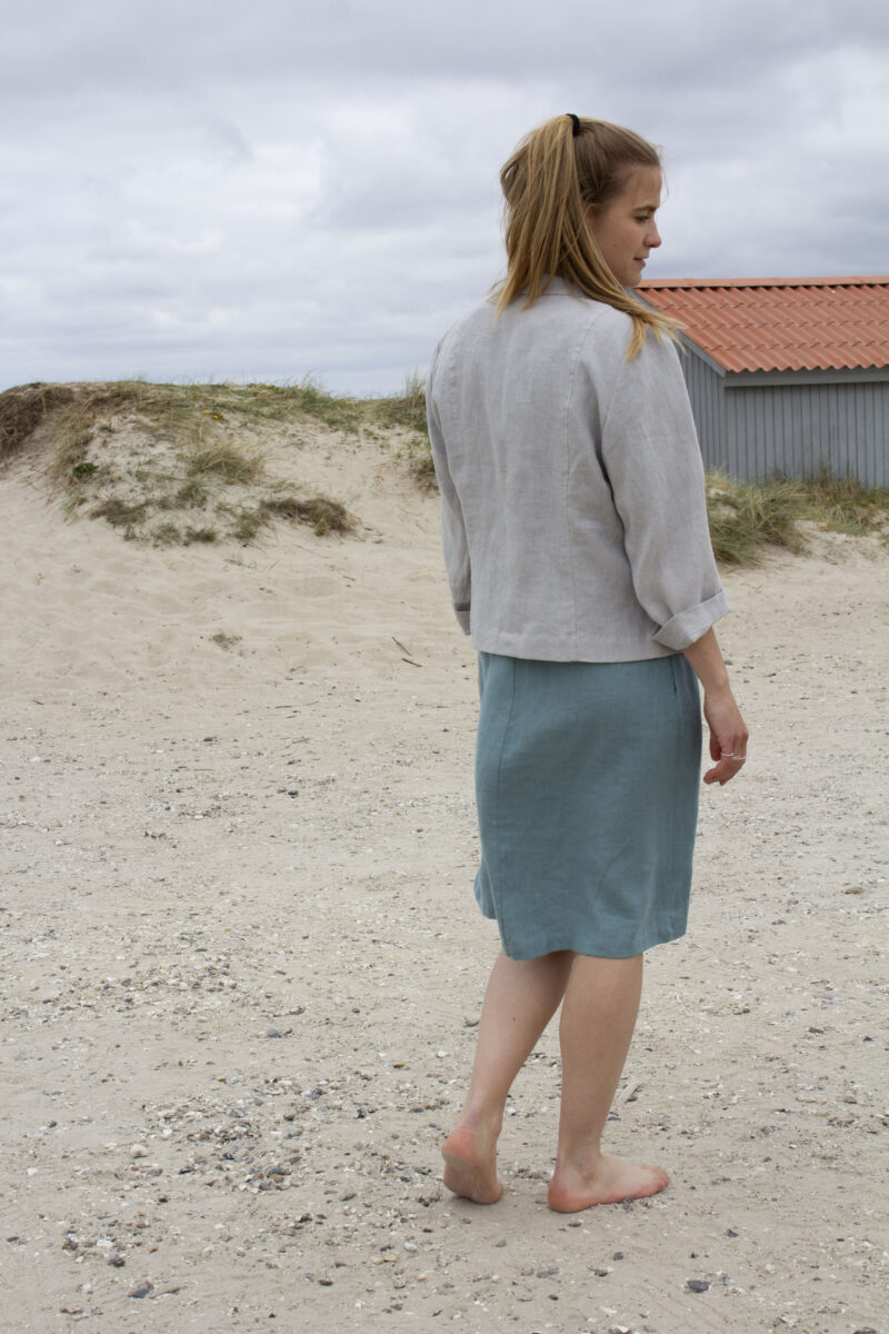 woman from the back in grey linen jacket and linen dress