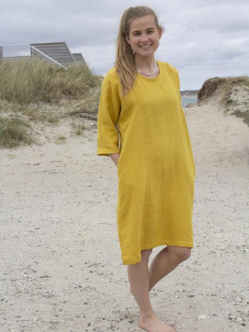 Woman in yellow linen dress