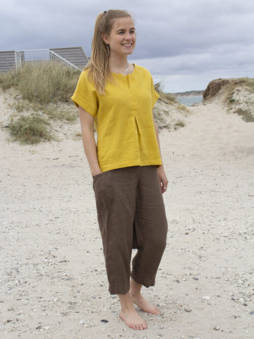 Woman in yellow linen top and brown linen pants