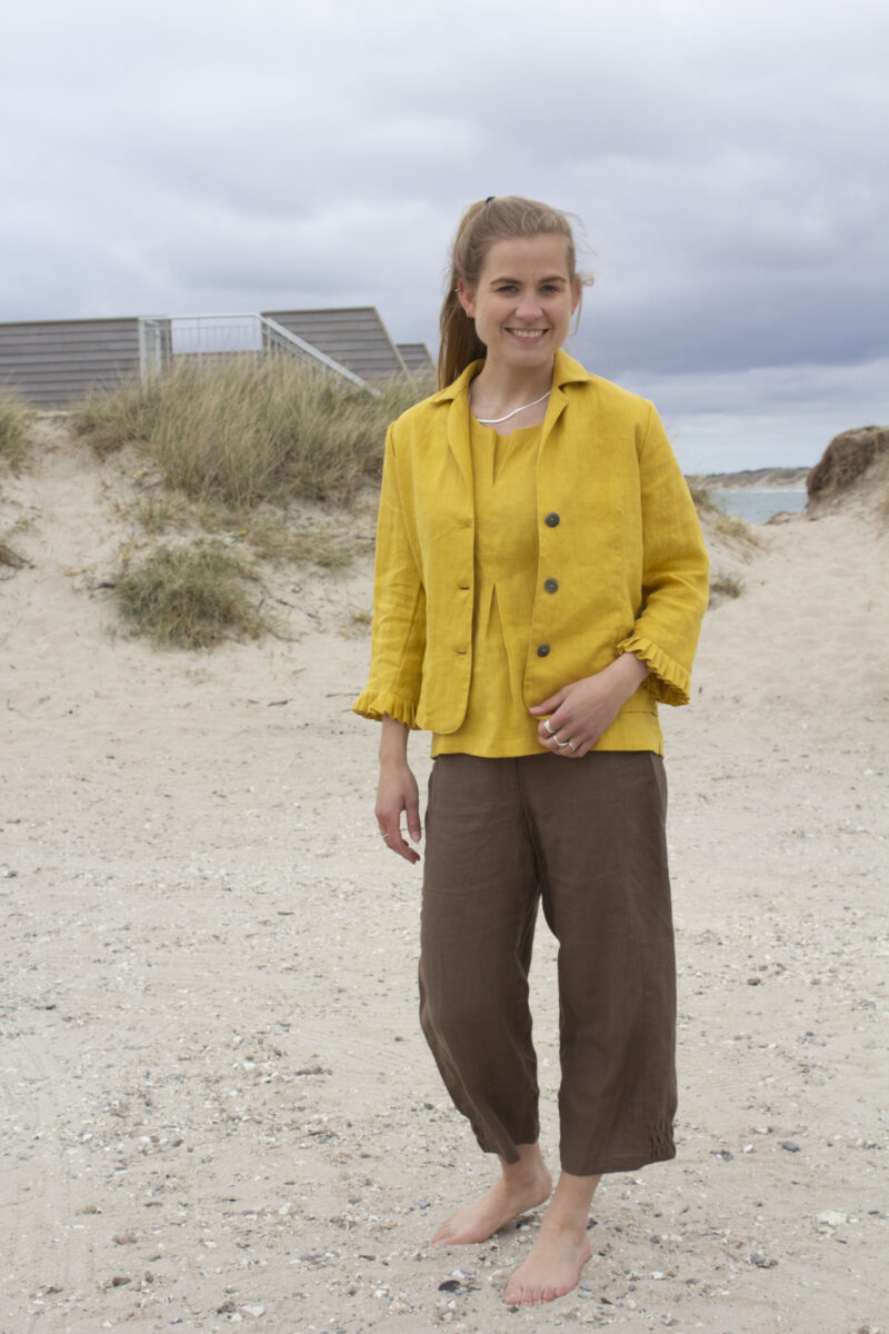 Woman in yellow linen jacket and top