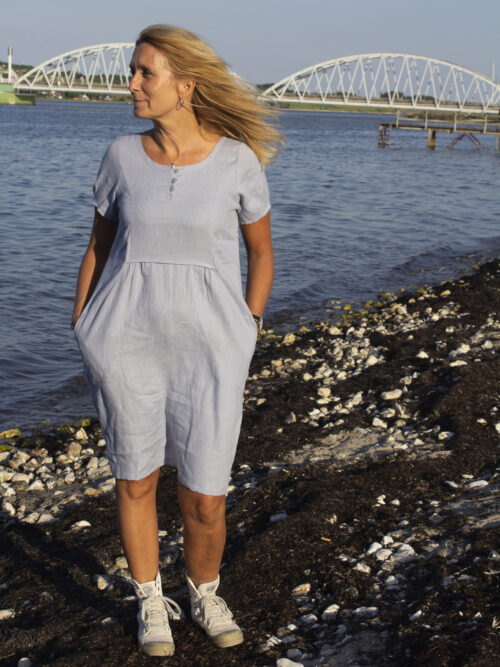 Woman wearing light blue linen dress