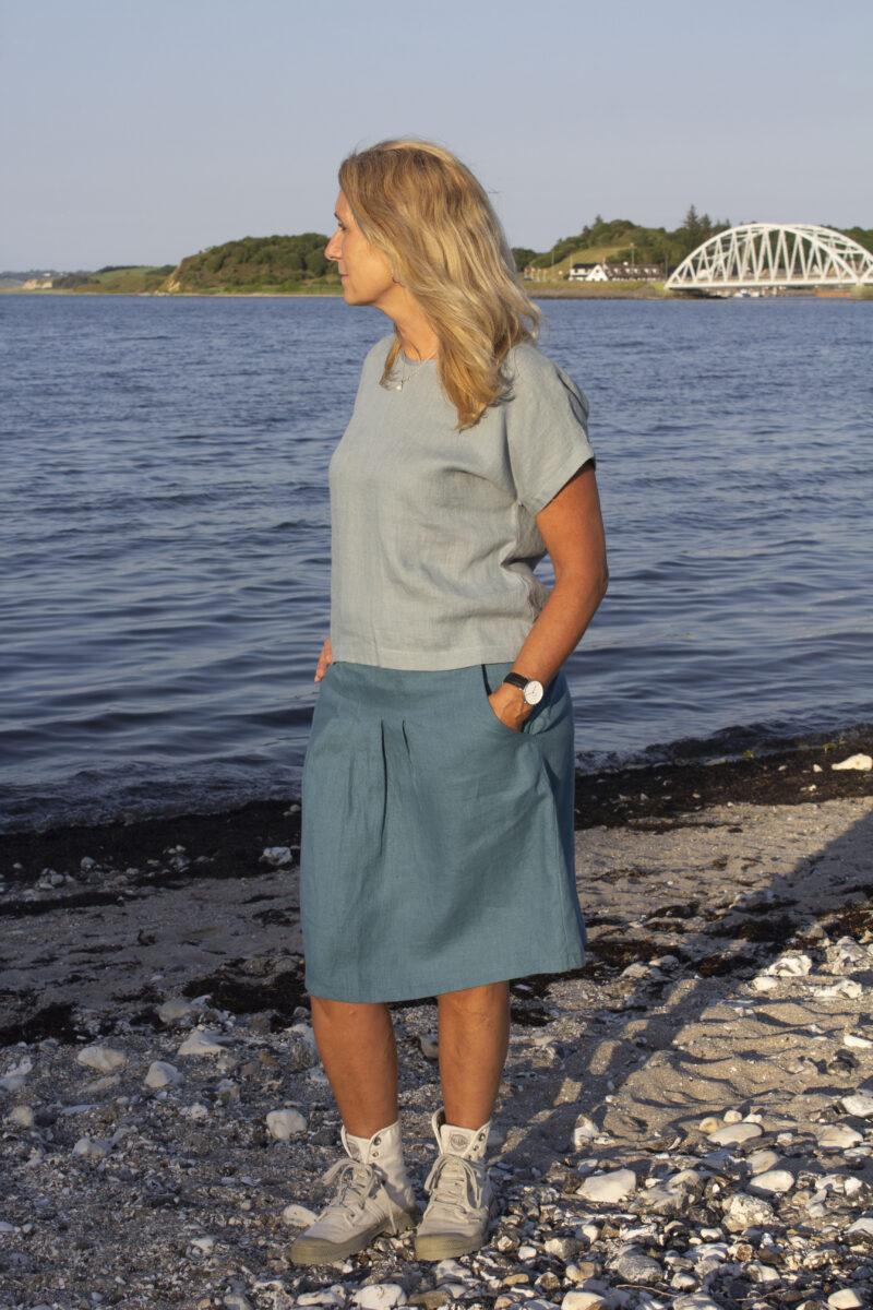 Woman in green blue linen skirt and blue linen top