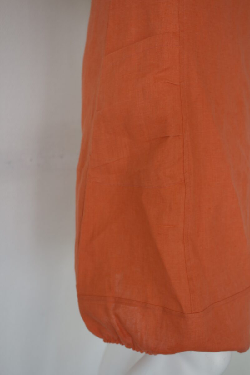 Orange linen dress bottom detail