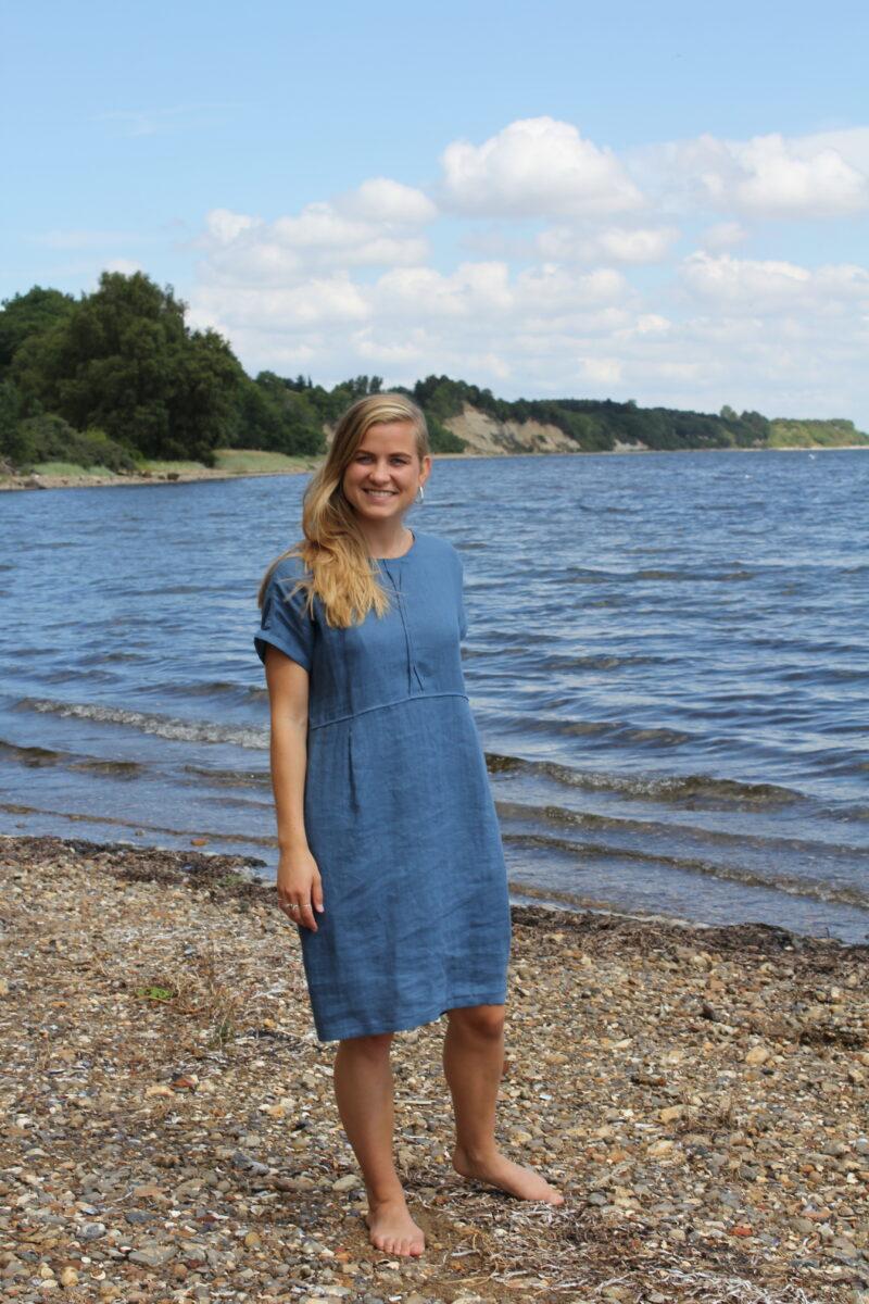 Woman in blue linen dress